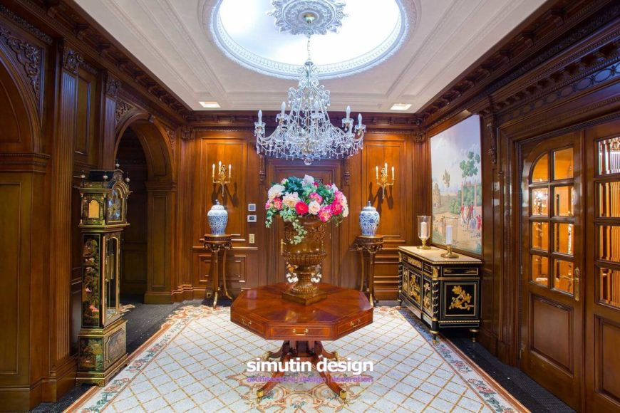 Hallway with a lighted dome ceiling and pocket doors.