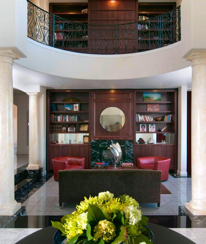 A Massive Curved Two Story Library And Living Room Features A Rich  Modern Style