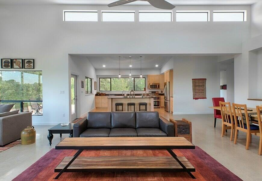 Small Pops Of Color Draw The Eye Around This Large, Open Concept Living Room