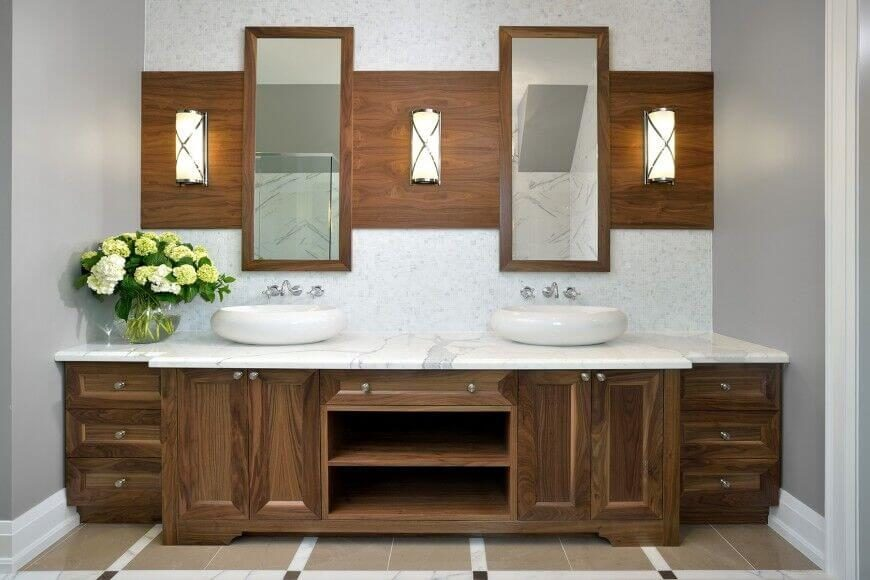 A simple yet elegant wood vanity with a rich wood grain matched with white marble countertops