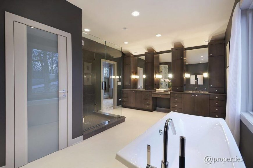 This Enormous Master Bathroom Features An Entire Wall Of Vanities With  Plenty Of Storage For Every