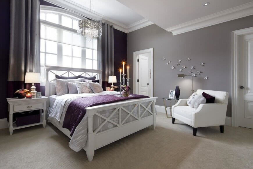 Pale lavender hues complement the use of bold purple accents while the white  furniture and trim