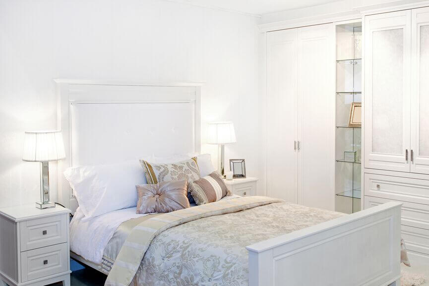 this glamorous room uses subtle muted accents to offset the use of some much white - White Bedrooms