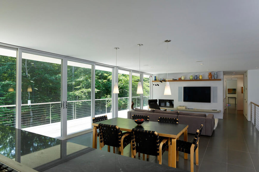 With the exterior wall being almost 100% glass panels, the home interior glows with warmth and natural light. This passive energy conservation helps the home achieve its Energy Star rating.