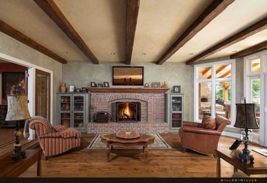 Etonnant The Large Red Brick Fireplace Is The Centerpiece Of This Rustic Living Room.  Natural Hardwood