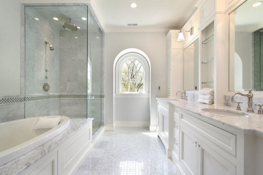 White, white, and more white. This stunning bathroom utilizes delicate veins of gray in the marble accents to create visual interest in this pale palette.