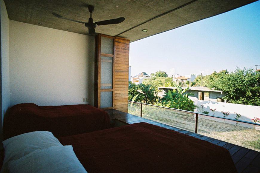 One of the two bedrooms in the cantilever. Both bedrooms look out over the pool and backyard, allowing for a stunning view of the surrounding city.