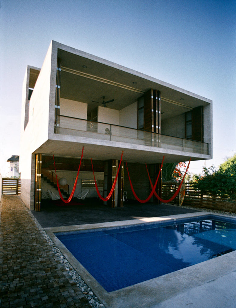 The cantilever - a rigid structure anchored at only one end to a (usually vertical) support from which it is protruding - was built to take the structural and tectonic abilities of the concrete to the limit. The space beneath the large cantilever is the most important space of the house, displaying the custom interior design and how to blends with the outdoors.