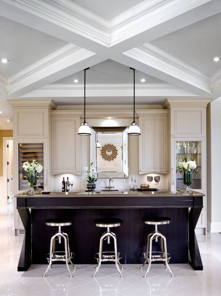 These stark, monochromatic pendants are great visual additions to this striking kitchen. The white shades offer a nice diffused light through out the room.