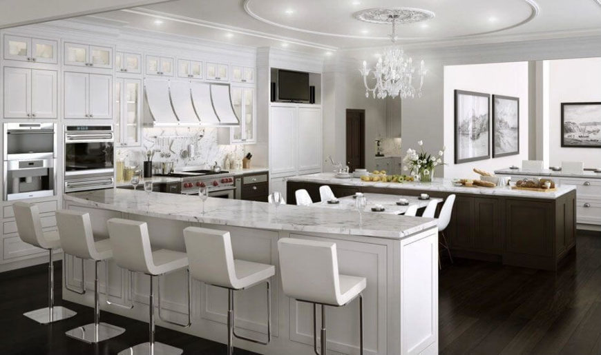 A stunning chandelier brings this already marvelous kitchen to a whole different level. The reflective crystals create a stunning light display on the counter tops and walls.