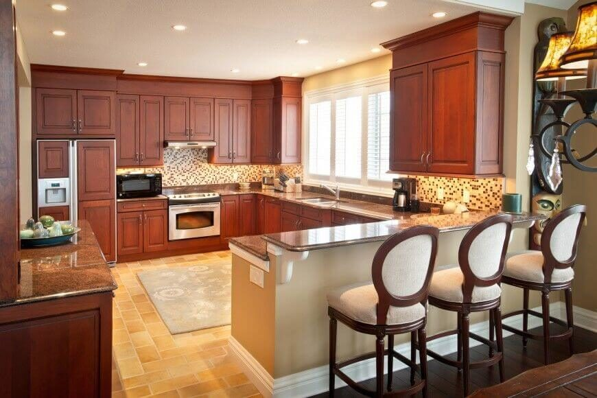 Neutral Shades Of Tan And Brown Highlight The Reddish Tones In The Wood  Cabinets. Gray