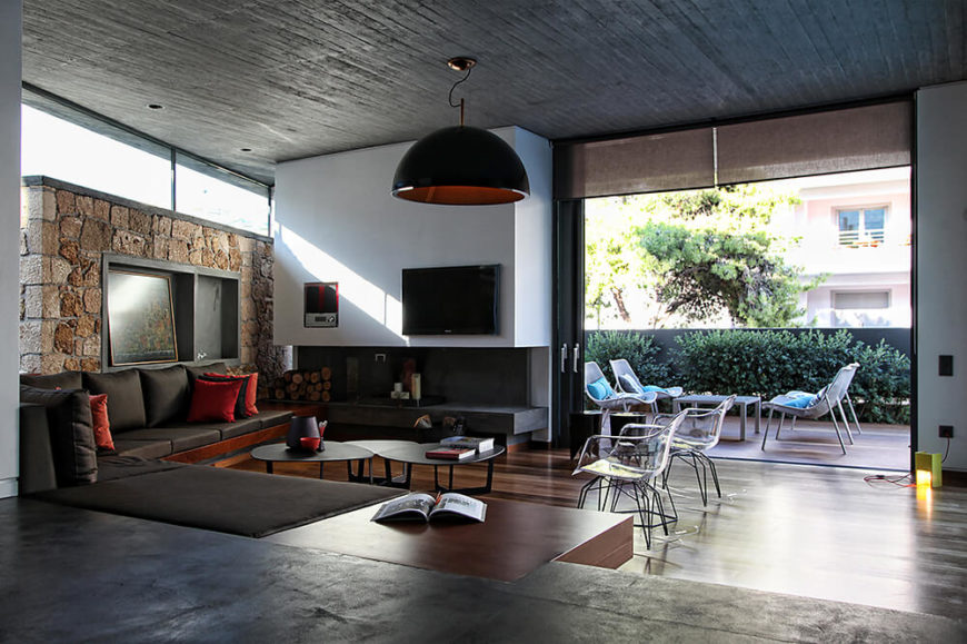 The living room of the house opens up to the courtyard and directly into the pool from easy access to the exterior of the house.