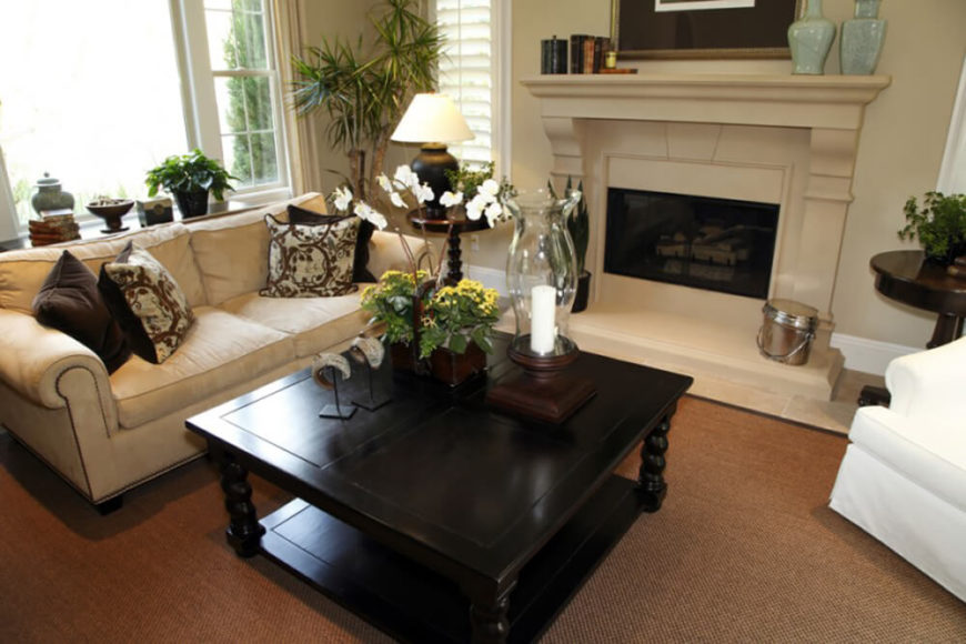 Carefully Selected House Plants Enhance The Dark Wood Used In The Furniture  Of The Room And
