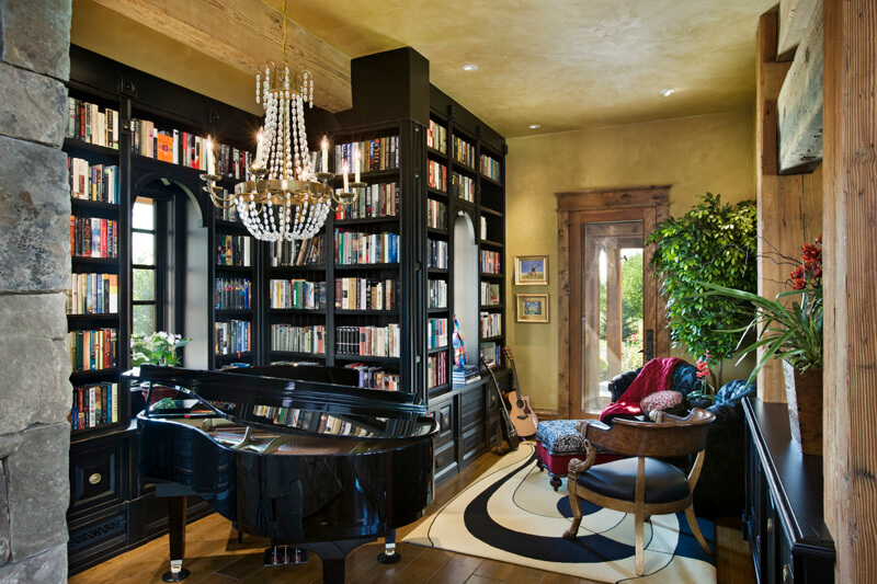 within a large rustic luxury home we find this splash of deep contrast a arrange office piano room