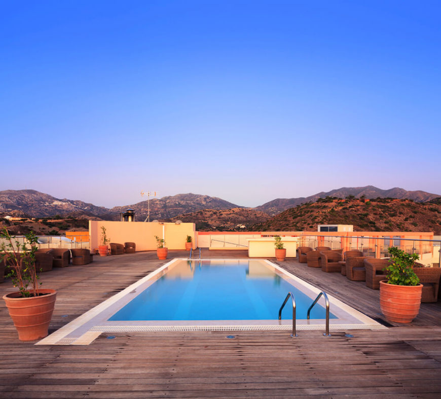 Looking out at the surrounding mountain range beyond creates a beautiful juxtaposition against the bright blue reflection on the pool surface. The rustic decking around the pool compliments the dessert landscape.