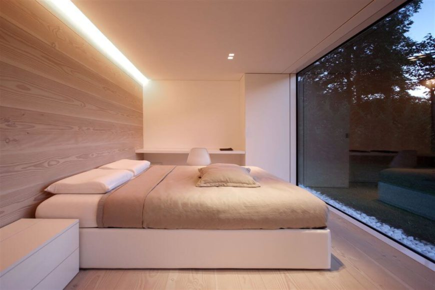This lovely minimalist bedroom allows the view