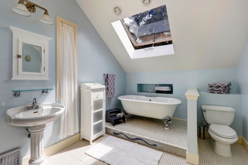 This Bathroom Features A Large Skylight Window, Allowing For Fresh Air And  Natural Sunlight To