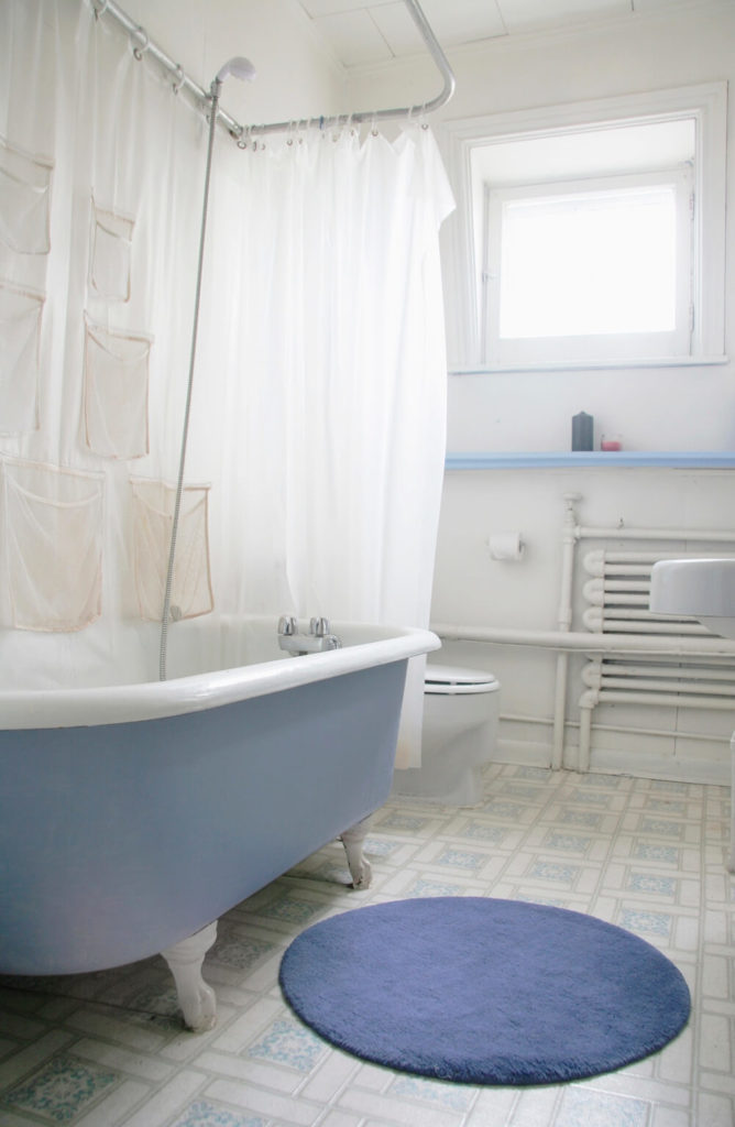 This Bright Bathroom Is Illuminated By Natural Light, However, The Stark  White Walls Combined