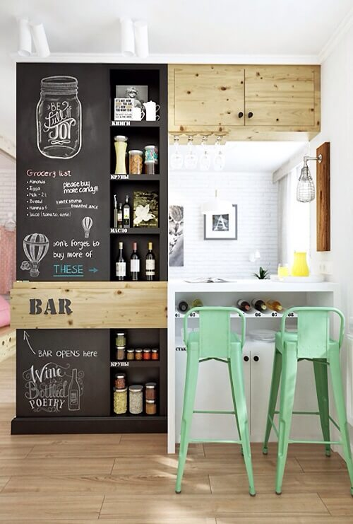 this is an eclectic small bar area with chalkboard cabinetry mixed