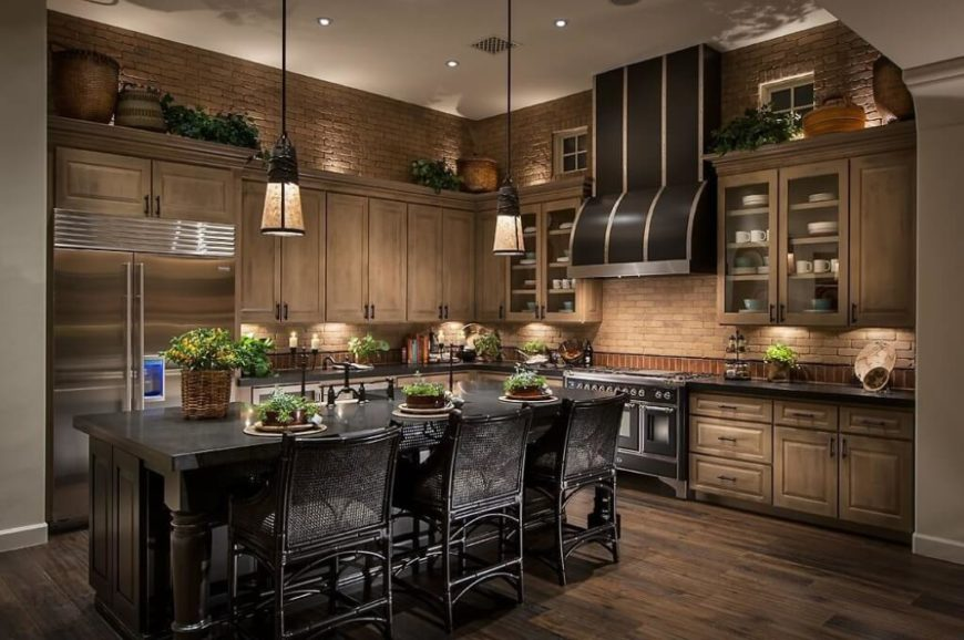 A luxurious dark kitchen with black scattered throughout and fantastic brick walls in place of a backsplash. The combination of brick and wood marks this kitchen as an old-world style.