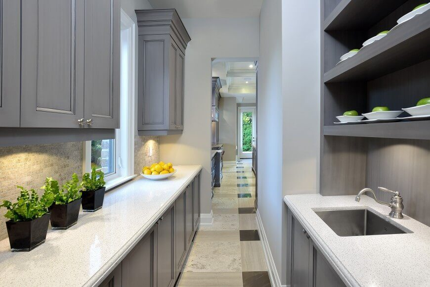 A Slim, Narrow Galley Kitchen With Tons Of Storage And A Large Sink. The