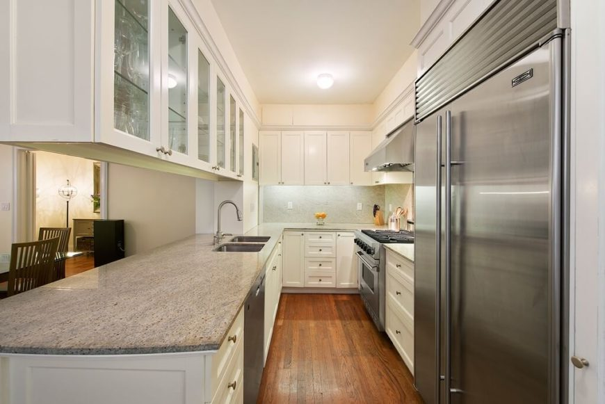 A Narrow Galley Kitchen With A Pass Through Countertop To The Formal Dining  Room.
