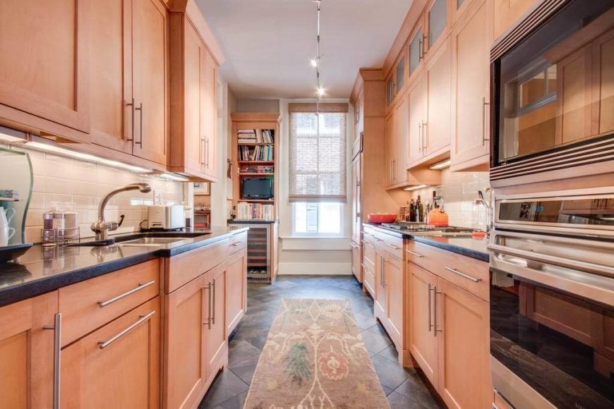 A Contemporary Light Wood Galley Kitchen With A Diamond Pattern Dark Tile  Floor, High