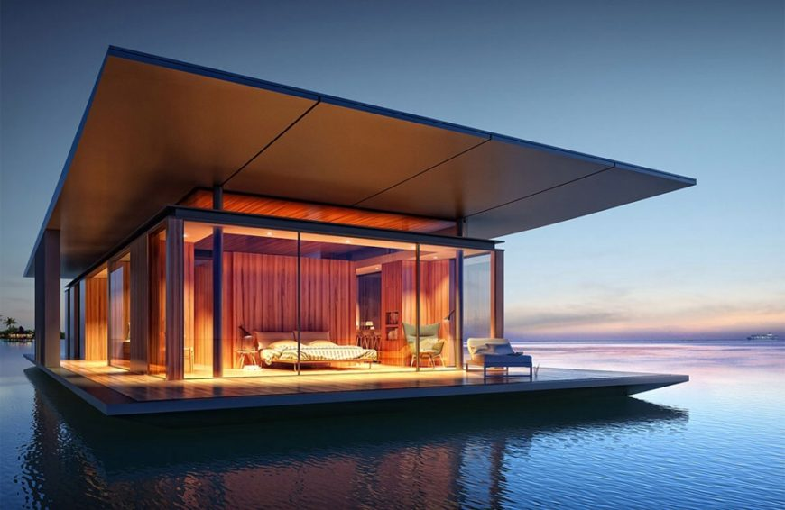 A floating home permanently moored off the coast of an island. The modern style home is wrapped in glass so that the view of the water and horizon is constant. The interior also features blackout curtains for when more privacy is desired.