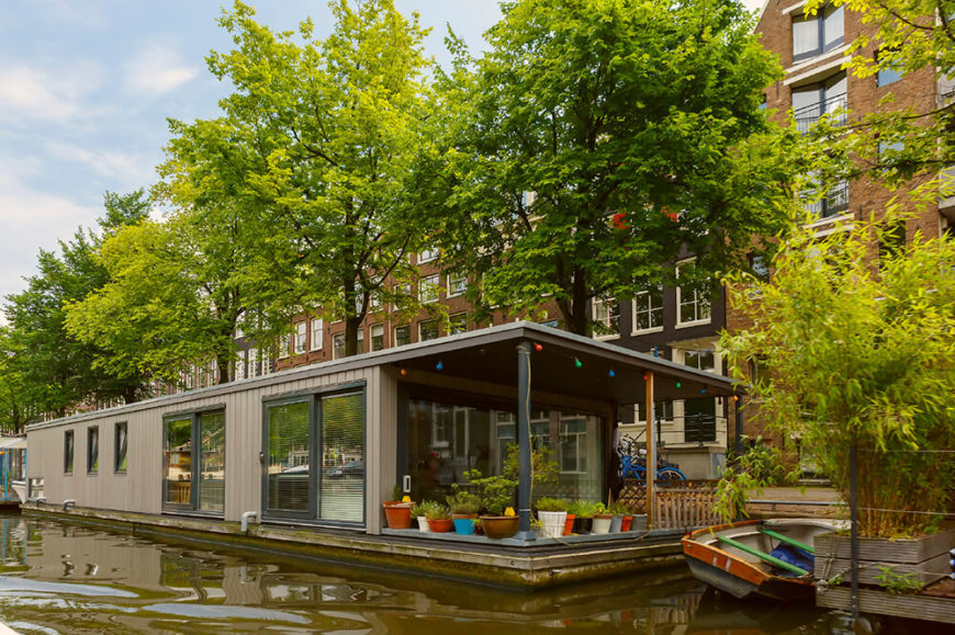 A lovely house boat with large sliding glass doors and a spacious open air covered deck.