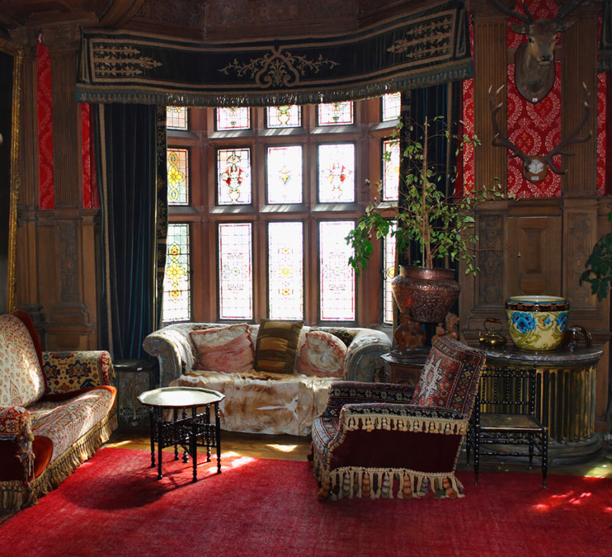 living room antique furniture. A Traditional Living Room Featuring Incredible Ornate Woodwork, Tapestries,  And Heavy Drapes Complete With Antique Furniture