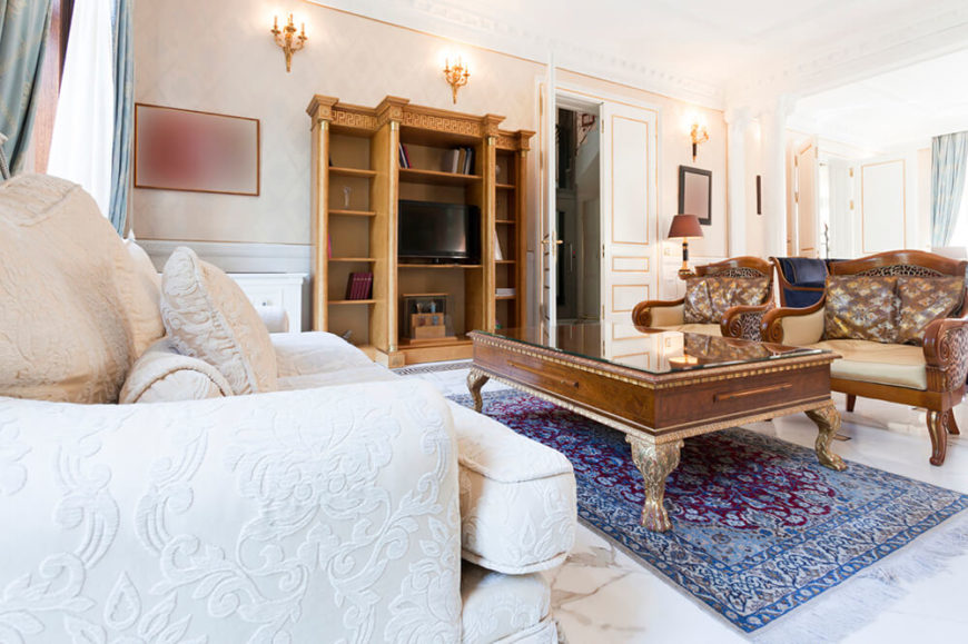 A Long Living Room With An Antique Bookshelf Serving As The Entertainment  Center, Along With