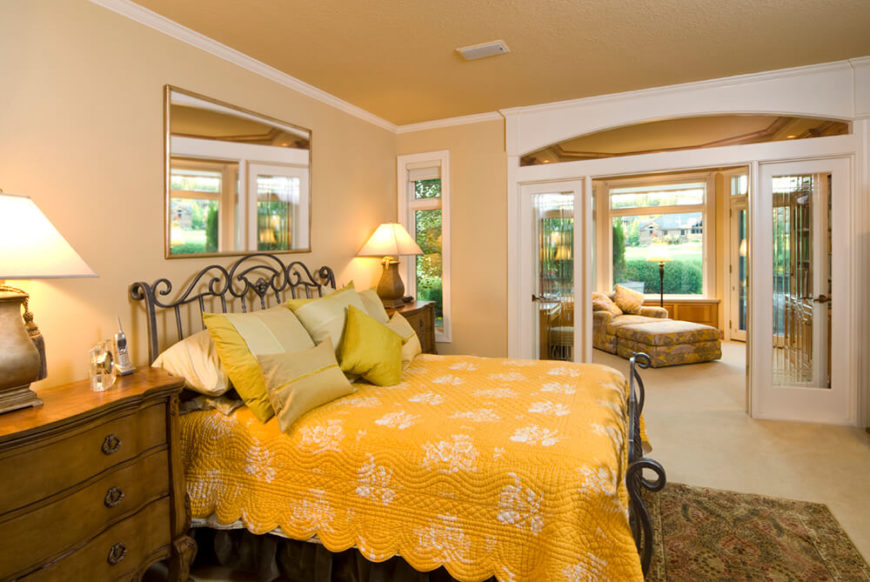 This Large Master Bedroom En Suite Features A Set Of Glass French Doors  Dividing The More
