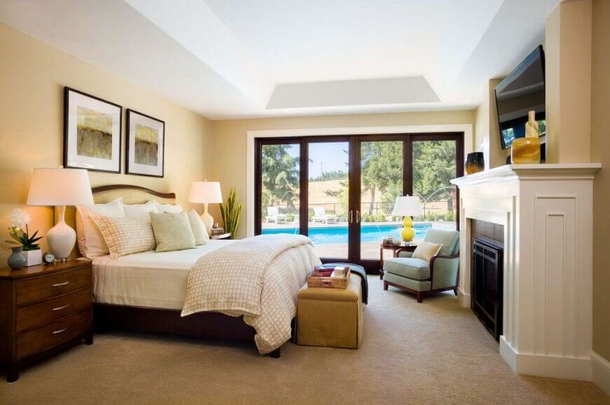 Soft Yellow Adds A Warm Glow To This Bedroom, Brightly Lit Via Sunlight  Through Full