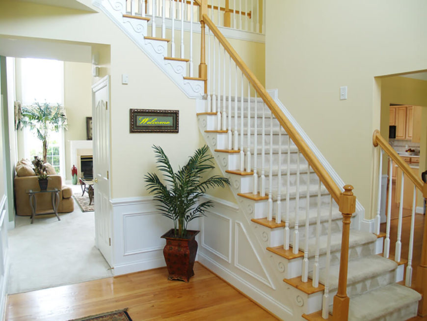 The Pale, Butter Yellow Walls Of This Foyer Acts As A Bridge Between The
