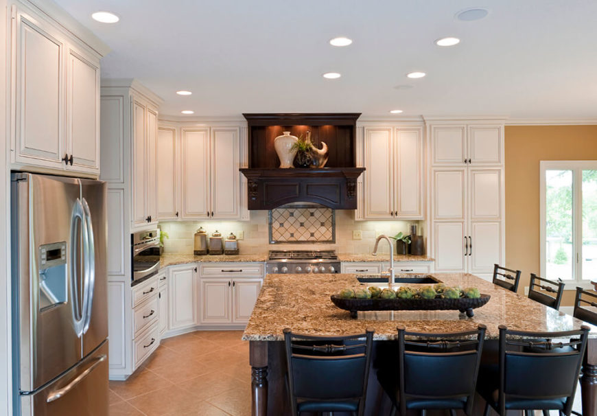 Dark Wood Successfully Breaks Up The Use Of White Cabinetry Against The Tan  Backdrop Created By