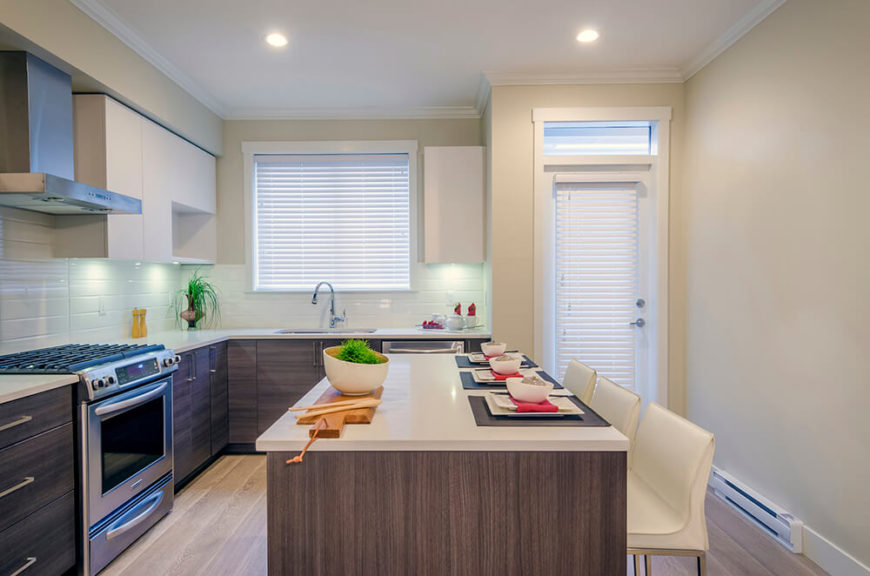 Cream Colored Chairs Match The Countertops And The Upper Cabinets While  Weathered Wood Makes Up The