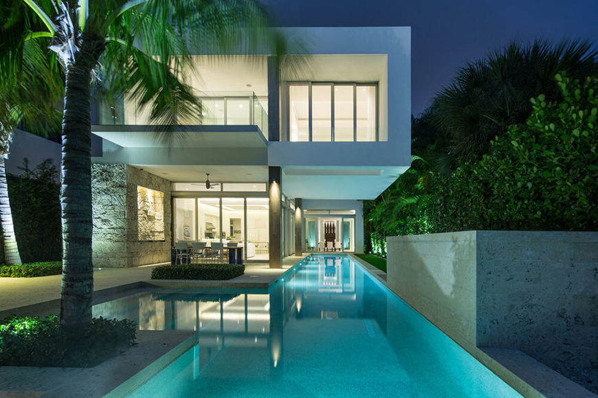 From the rear edge of the pool, we look back at the home, noting the expanse of windows and overhanging portions that shield the owners from the hot midday sun.