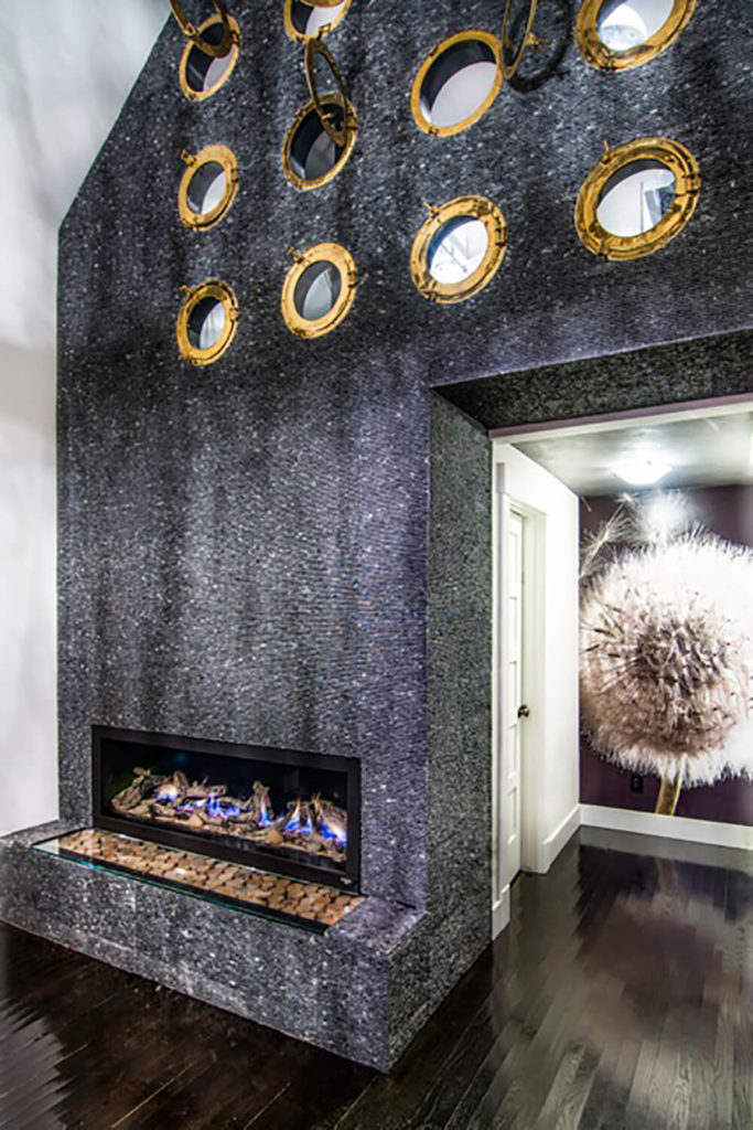 The Unique Fireplace, Crafted From Recycled Travertine Tile And Marble,  Reaches Up And Over