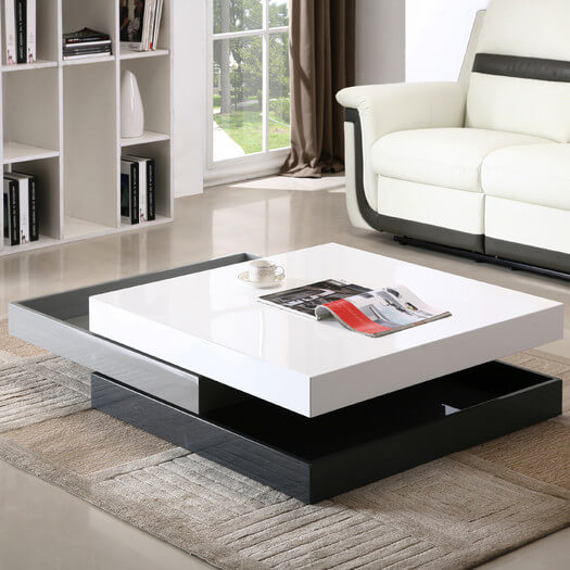 This table has a super unique feature that we love: the body can actually be slid open to reveal inner storage and change the look of the piece. Here it's pictured in its open configuration, with the middle tier slid to the left, opening up a pair of storage drawers while leaving the table top intact.