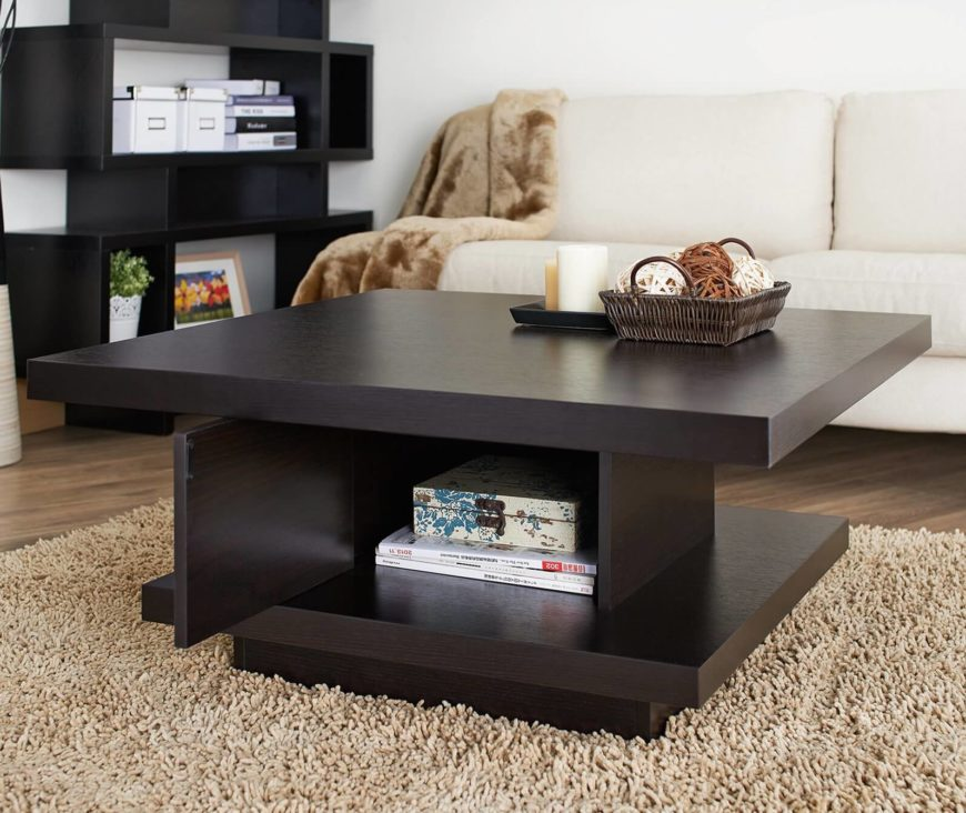 Somewhat similar to our first model, this coffee table features rich dark wood tones in a sharply defined frame. The thick base provides extra room for storage or display, while the top helps it fit seamlessly in a range of possible rooms.