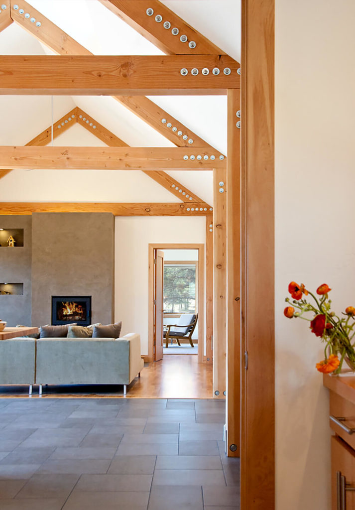 The massive natural wood exposed beams run the length of the house, ensuring a solid and functional look that's equal parts utilitarian and warmly aesthetic.