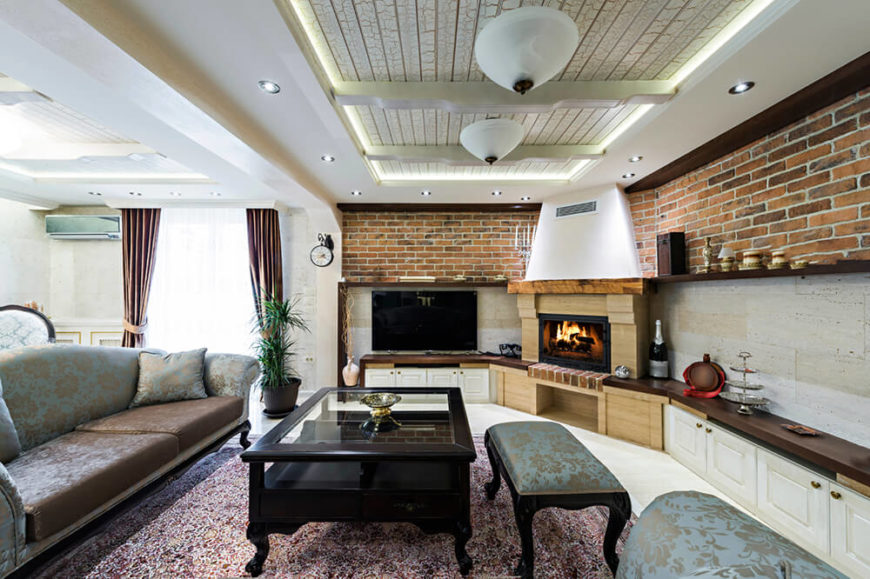 Brick not only mingles well with other types of brick styles and patterns. In this living room, three different types of brick were used, that, when combined with more traditional furniture, allows for just about any decorative choice.