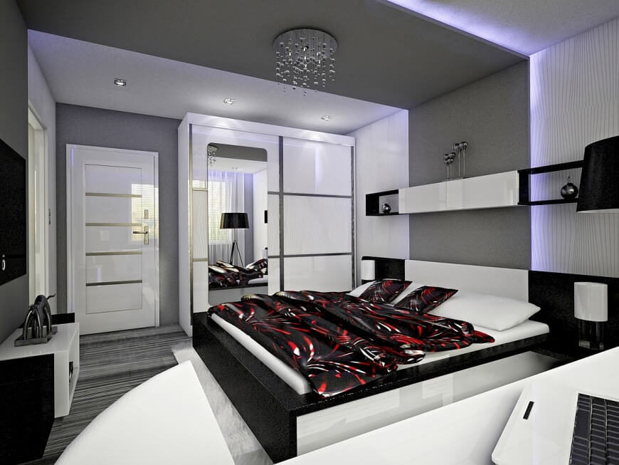 This Bedroom Has A Prevalent Black And White Color Scheme, Accented Only By  The Bedding