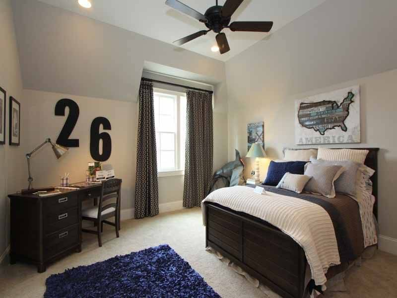 A Smaller Bedroom Space That Utilizes The Area Well. The Bed Features A  Dark Stained