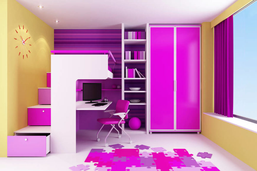 This bedroom is full of vibrant purples and pinks. The clean white surfaces on the floor and desk space help to accent the other colors in the room. The bed is actually right above the desk area, maximizing space potential. A large window to the right helps to keep the room bright and lively by letting in natural light.
