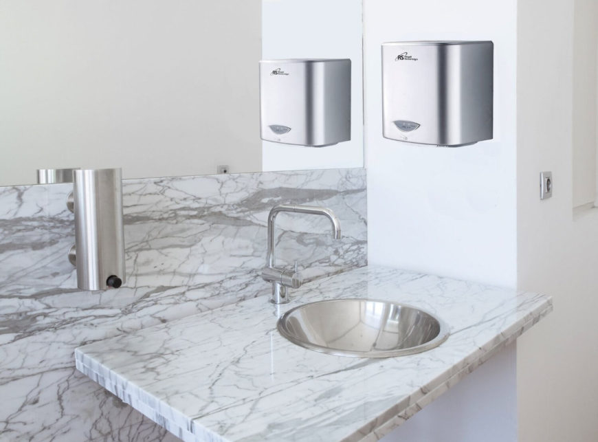 We've got a photo of this hand dryer placed in a contemporary home bathroom, to showcase how its brushed metal body complements a white space with marble countertop. This model boasts a 20 second running time, plenty to dry any hands.