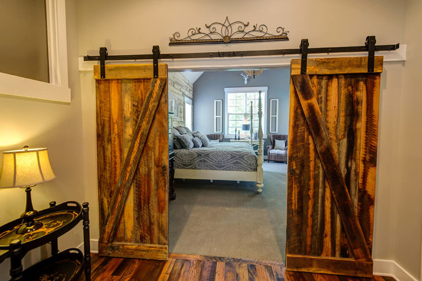 Likewise with the master bedroom entrance, the rolling barn doors, complete with wrought iron door wheels, lend to the home a sense of strength and built-to-last materials.