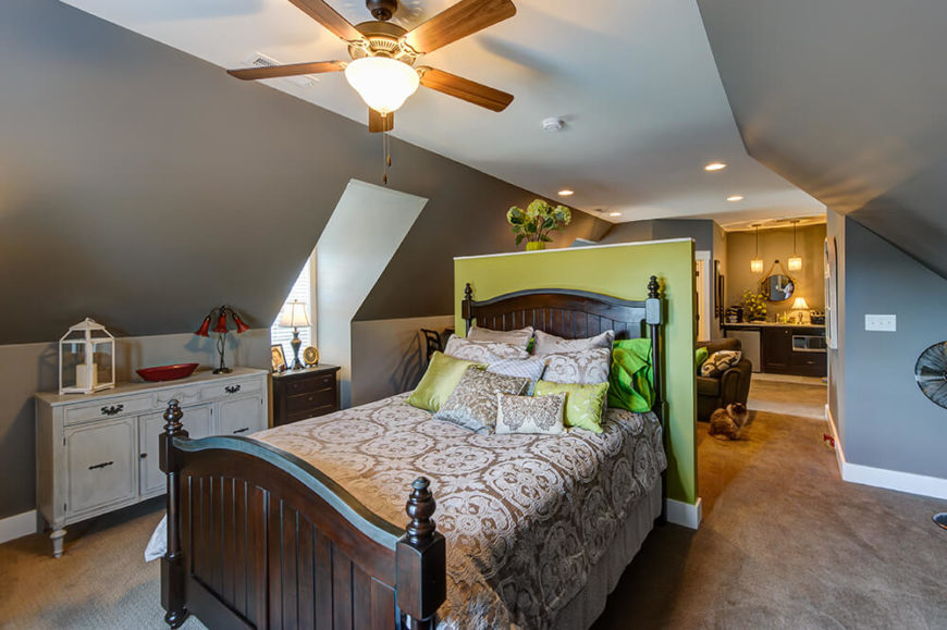 Finally, the third bedroom turns a curved ceiling, rear-yard facing windows, and a small dividing wall into a innovative sleeping/entertainment space. Just down the hall is a bathroom and kitchenette.