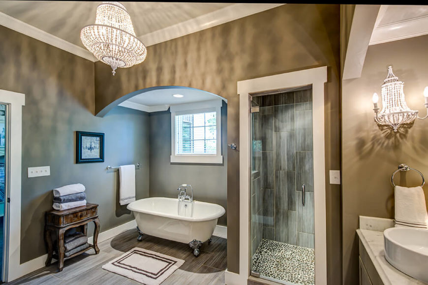 Also nestled next to the shower, a clawfoot tub sits tantalizing beneath a half window. The bathroom offers ample space without feeling like a mausoleum.