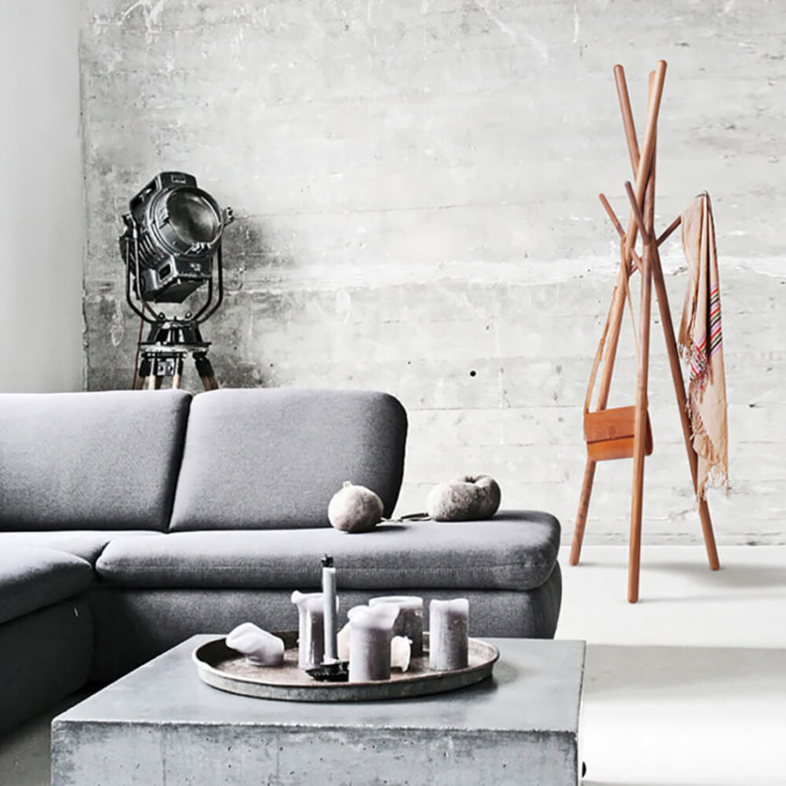 Even in a modern-industrial design like this one, the Nude Landing coat rack finds itself perfectly at home against the cold concrete wall and accents. It has a gorgeous finish that shows off the natural wood grain in each piece.